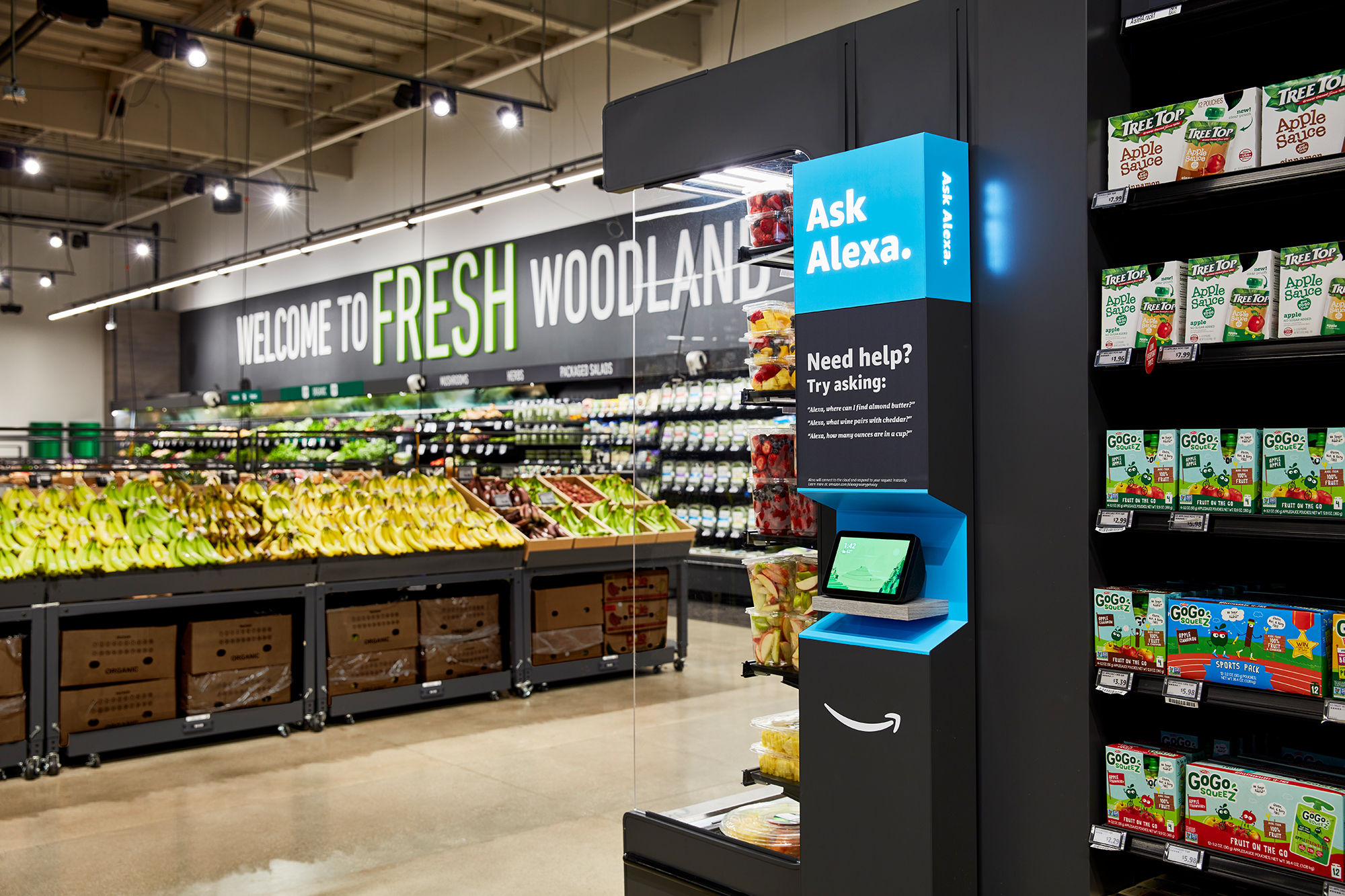 At Amazon's newest grocery store, you can ask Alexa voice assistants where to find milk, scan and check out your groceries using your shopping cart, and pick up books you ordered off the e-commerce giant's website. (Amazon via CNN)