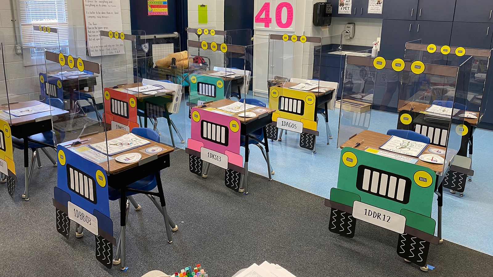 The teachers at St. Barnabas Episcopal School spent a week redesigning classroom desks, which feature construction paper tires, headlights and license plates. (Courtesy Patricia Dovi via CNN)