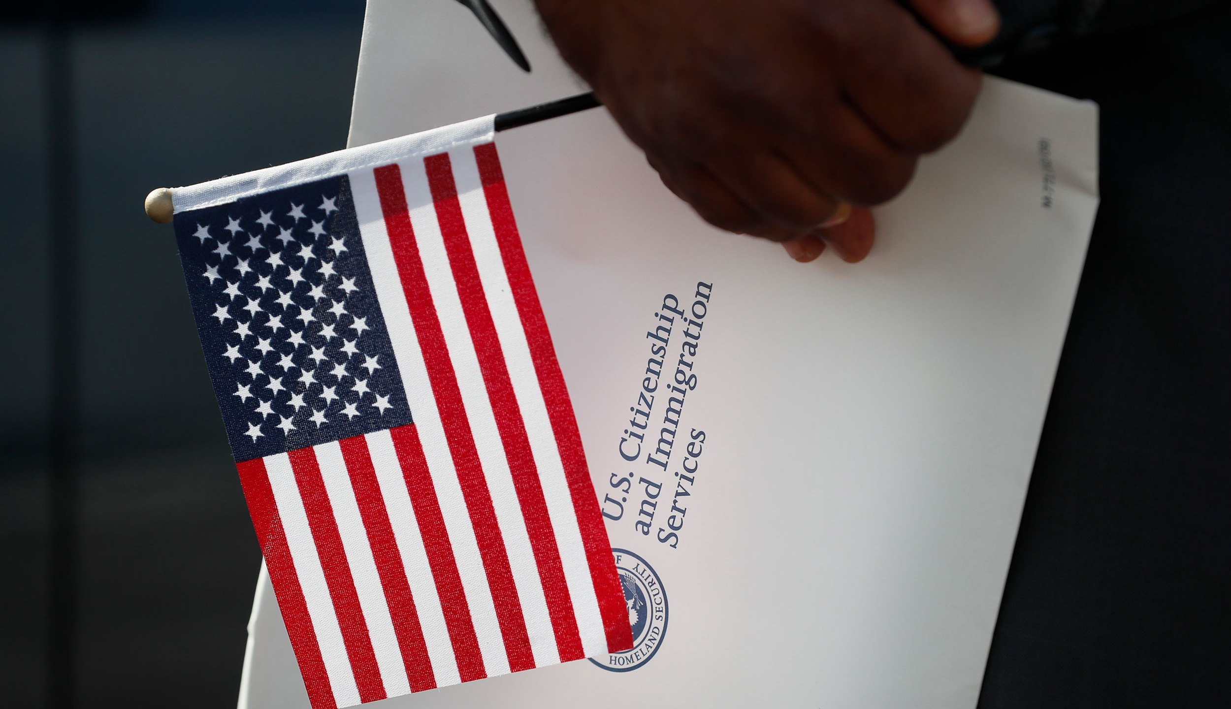 A record number of people are giving up their US citizenship, new research published on Sunday found. (Charlie Neibergall/AP)