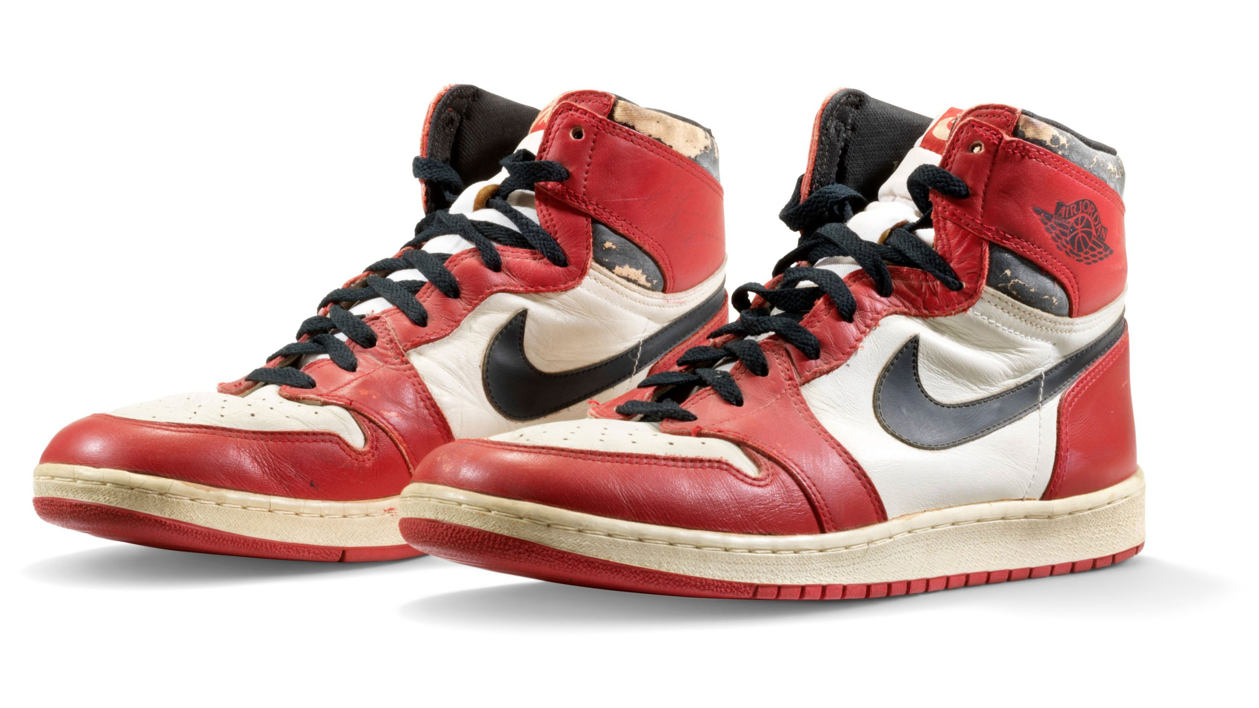 A pair of Michael Jordan's sneakers from 1985 have sold at auction for $615,000. (CNN)