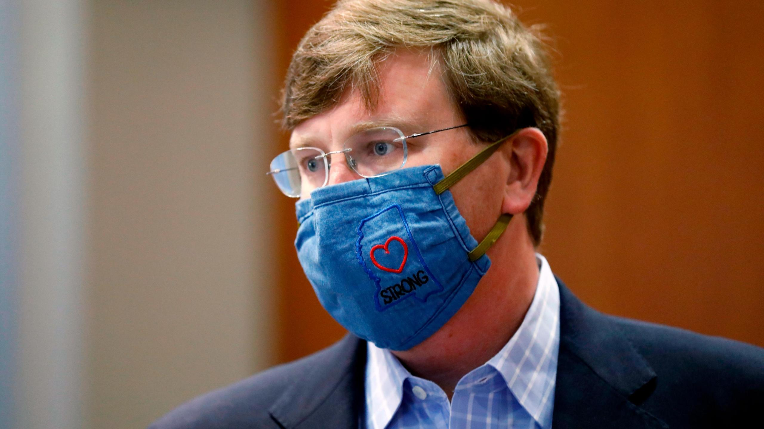 """Gov. Tate Reeves sports a """"Mississippi Strong"""" face mask following a July 8, 2020, coronavirus news briefing in Jackson. (Rogelio V. Solis/AP)"""