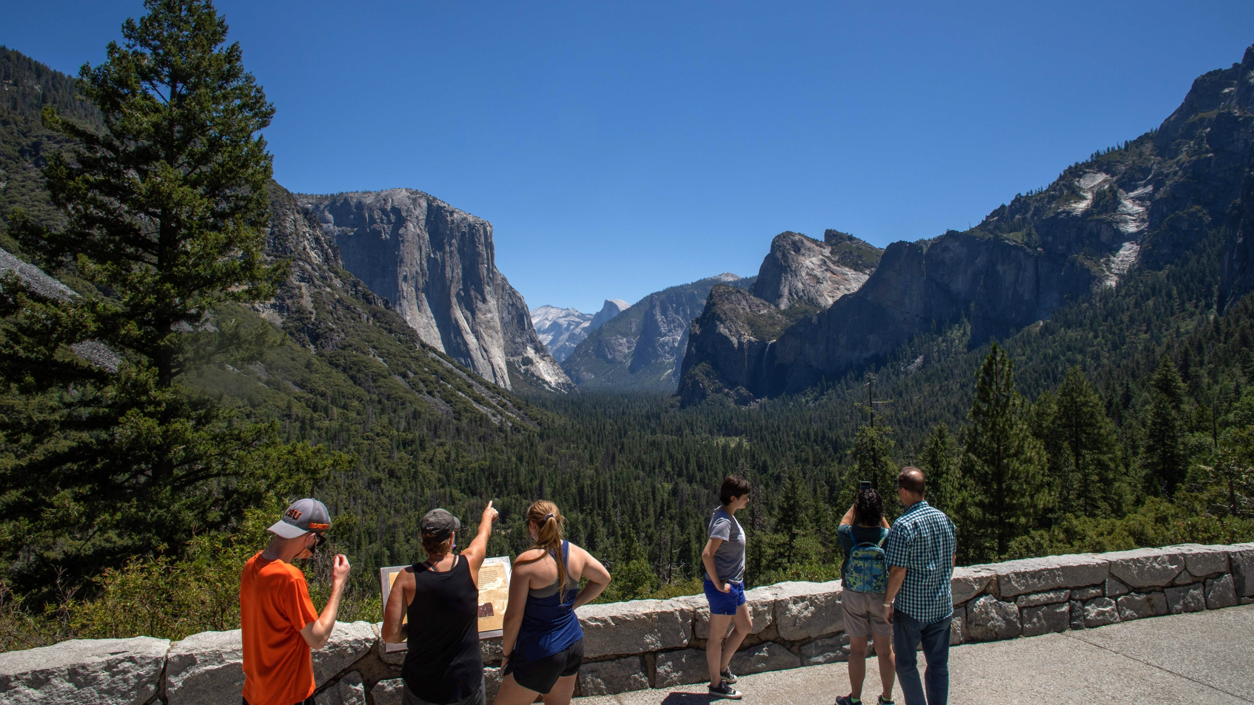 Visitors walk to the Tunnel View lookout in Yosemite Valley at Yosemite National Park on July 08, 2020. (APU GOMES/AFP via Getty Images)