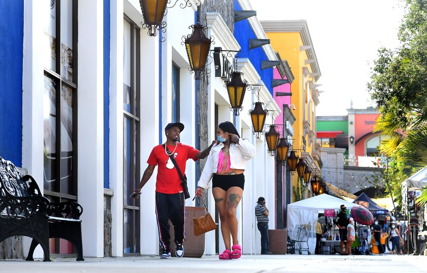 Customers walk at the Plaza Mexico in Lynwood amid the coronavirus crisis in this undated photo. (Wally Skalij/Los Angeles Times)