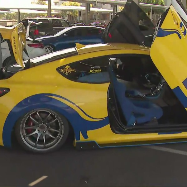 The nonprofit Operation Warm Wishes teamed up with Drive United to offer free groceries to families in need while entertaining them with a car show at Tustin High School on Aug. 8, 2020. (KTLA)