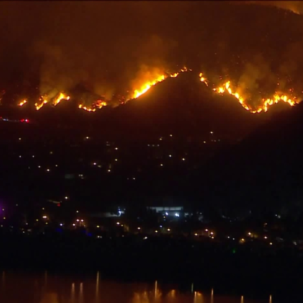 The Ranch 2 Fire burns above homes in Azusa on Aug. 13, 2020. (KTLA)