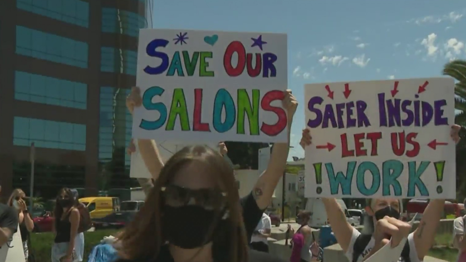 Salon owners and hair stylists protests pandemic-related restrictions during a demonstration in Westwood on Aug. 12, 2020. (KTLA)