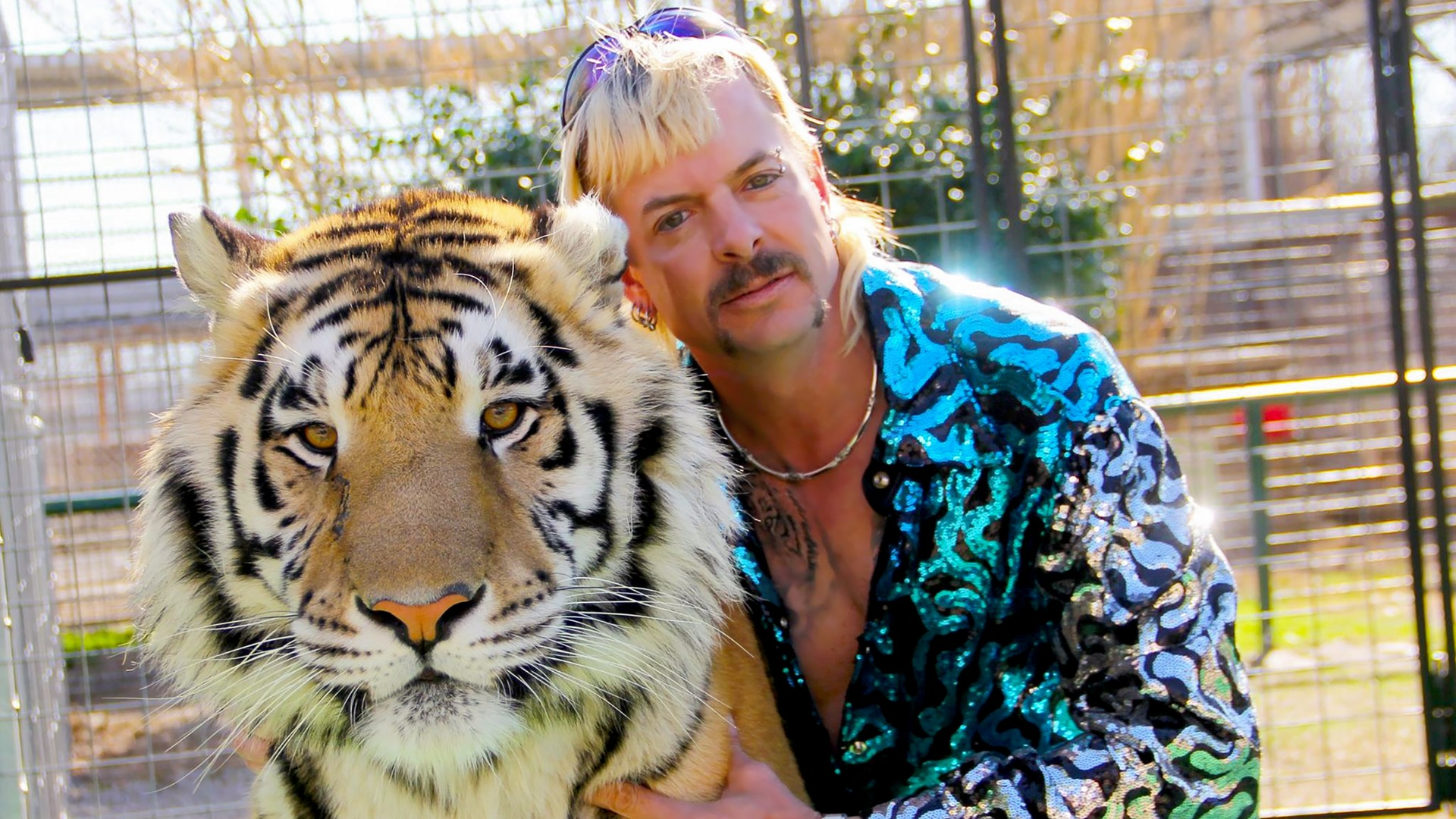 "Joseph Maldonado-Passage aka Joe Exotic and one of his cats in the Netflix docuseries ""Tiger King: Murder, Mayhem and Madness."" The zoo closed after a federal agency suspended its license. (NETFLIX/Courtesy of NETFLIX via CNN Wire)"