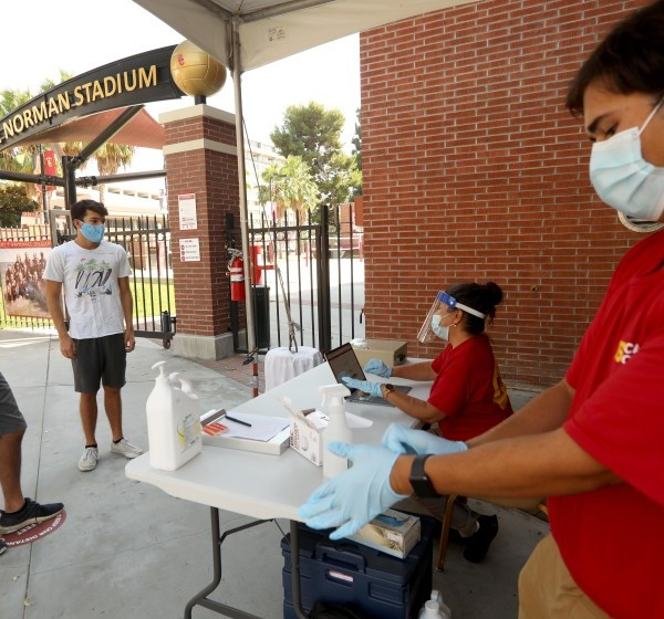 USC student Mitchell Steimle, left, and his brother Anthony participate in a wellness check on Aug. 17, 2020, the first day of academic instruction for the fall 2020 semester.(Genaro Molina / Los Angeles Times)