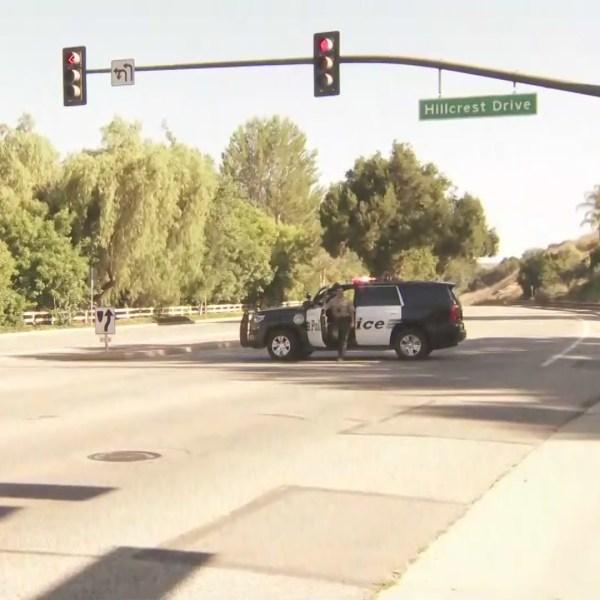 Officers investigate a deadly crash on Westlake Boulevard near Skelton Canyon Circle Drive on Aug. 2, 2020. (KTLA)