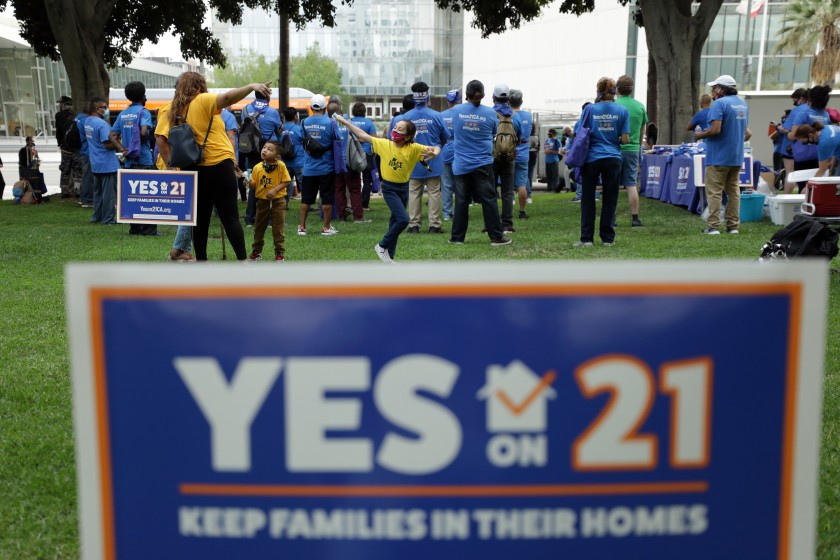"A ""Celebrate Renters Rally"" in support of Proposition 21, a statewide rent control ballot measure, is held at Los Angeles City Hall. (Myung J. Chun / Los Angeles Times)"