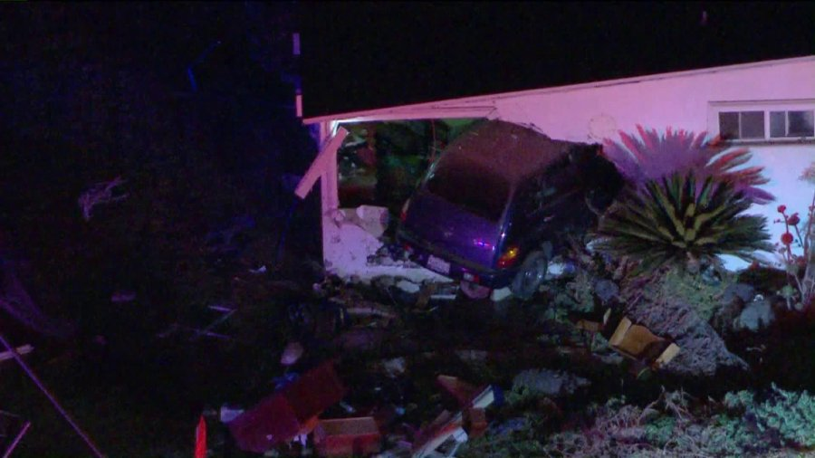 A woman died after a car crashed into a Pomona home on Sept. 17, 2020. (KTLA)