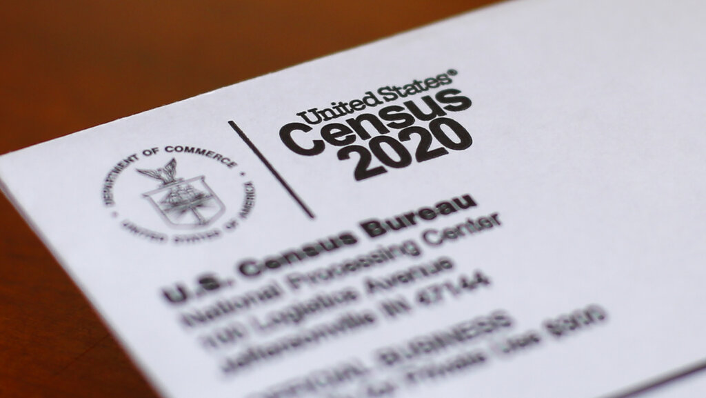 This Sunday, April 5, 2020, photo shows an envelope containing a 2020 census letter mailed to a U.S. resident in Detroit. (AP Photo/Paul Sancya, File)