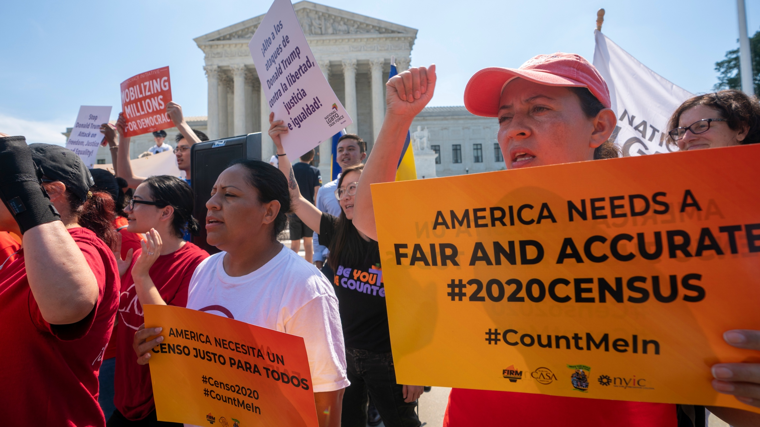 Demonstrators gather at the Supreme Court as the justices finish the term with key decisions on gerrymandering and a census case involving an attempt by the Trump administration to ask everyone about their citizenship status in the 2020 census, on June 27, 2019. (J. Scott Applewhite / Associated Press)