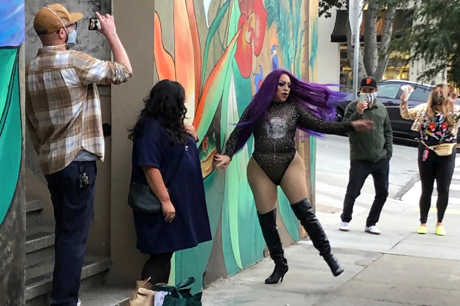 This Aug. 28, 2020 photo shows Amoura Teese, center, performing on a sidewalk for customers in San Francisco. (AP Photo/Haven Daley)
