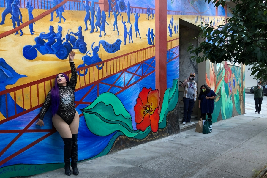 This Aug. 28, 2020 photo shows Amoura Teese performing on a sidewalk for customers in San Francisco. (AP Photo/Haven Daley)