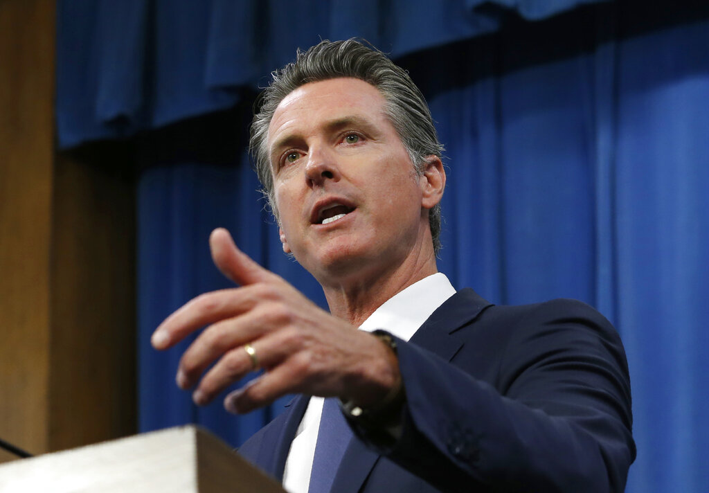 In this July 23, 2019, file photo, Gov. Gavin Newsom talks to reporters at his Capitol office, in Sacramento.(AP Photo/Rich Pedroncelli, File)