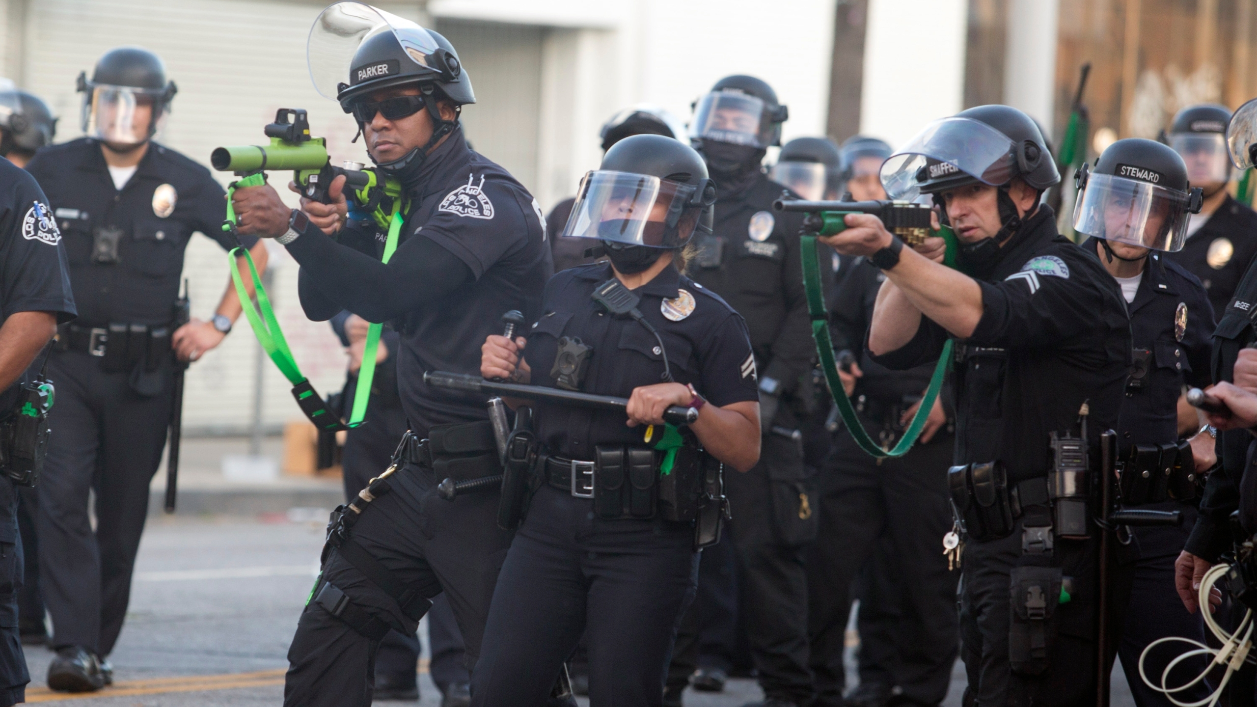 Police aim weapons on demonstrators protesting the death of George Floyd in Los Angeles, Saturday, May 30, 2020. (AP Photo/Ringo H.W. Chiu, File)