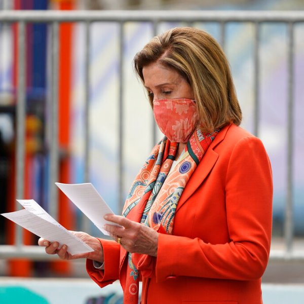 House Speaker Nancy Pelosi looks over her notes before speaking at a news conference at the Mission Education Center Elementary School, Wednesday, Sept. 2, 2020, in San Francisco. (AP Photo/Eric Risberg)