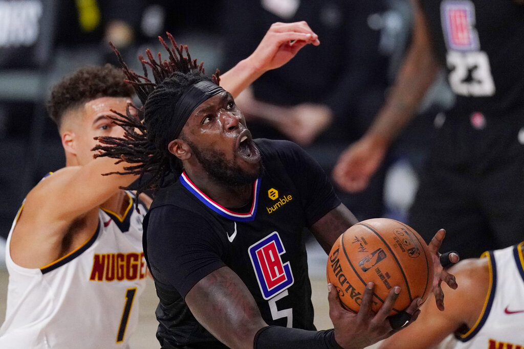 Los Angeles Clippers' Montrezl Harrell drives to the basket past Denver Nuggets' Michael Porter Jr. in the second half of an NBA conference semifinal playoff basketball game Thursday, Sept 3, 2020, in Lake Buena Vista Fla. (AP Photo/Mark J. Terrill)