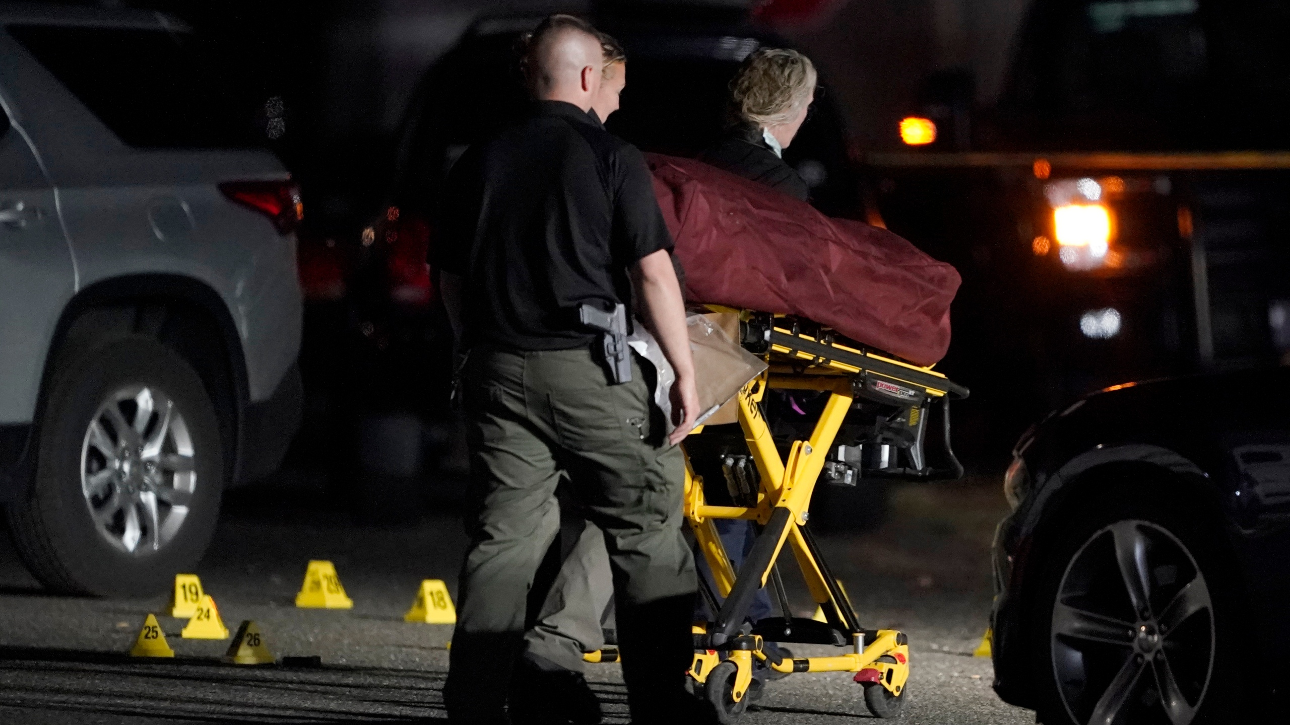 The body of Michael Reinoehl is taken away on a stretcher in the early morning hours of Sept. 4, 2020, in Lacey, Washington. (Ted S. Warren / Associated Press)