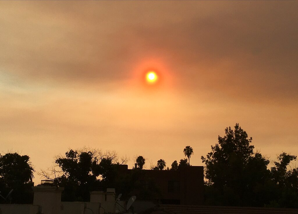 Smoke from wildfires clouds the sky over greater Los Angeles, Sunday, Sept. 6, 2020, as seen from Pasadena, Calif. (AP Photo/John Antczak)