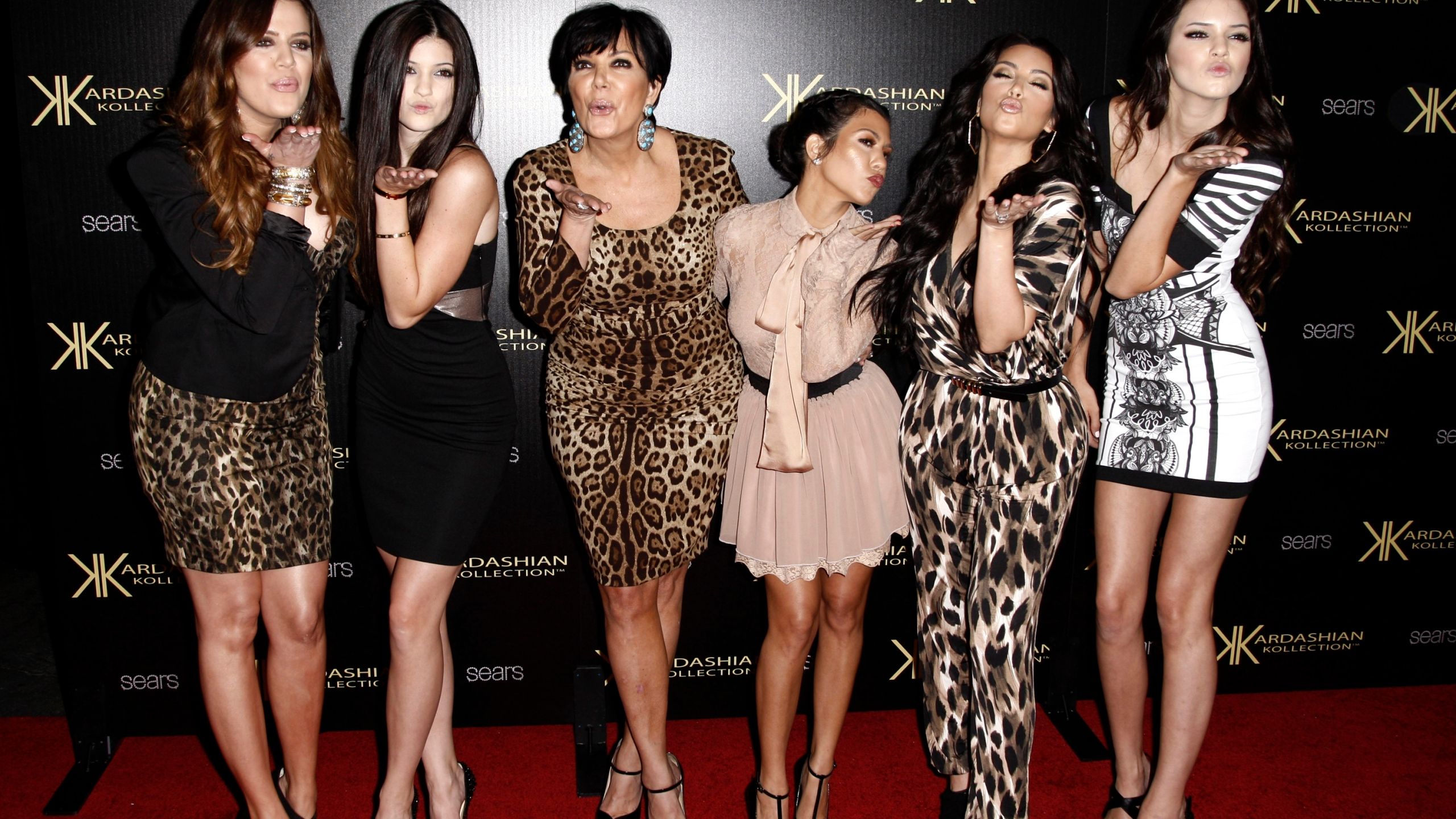 Khloe Kardashian, Kylie Jenner, Kris Jenner, Kourtney Kardashian, Kim Kardashian, and Kendall Jenner arrive at the Kardashian Kollection launch party in Los Angeles on Aug. 17, 2011. (AP Photo/Matt Sayles, file)