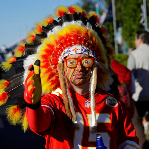 In this Feb. 2, 2020 file photo, a Kansas City Chiefs fan walks outside the stadium before the NFL Super Bowl 54 football game between the San Francisco 49ers and Kansas City Chiefs in Miami Gardens, Fla. (AP Photo/Seth Wenig) File)