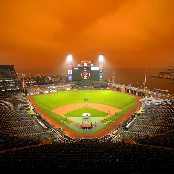 Smoke from California wildfires obscures the sky over Oracle Park as the Seattle Mariners take batting practice before their baseball game against the San Francisco Giants on Sept. 9, 2020, in San Francisco. (Tony Avelar / Associated Press)
