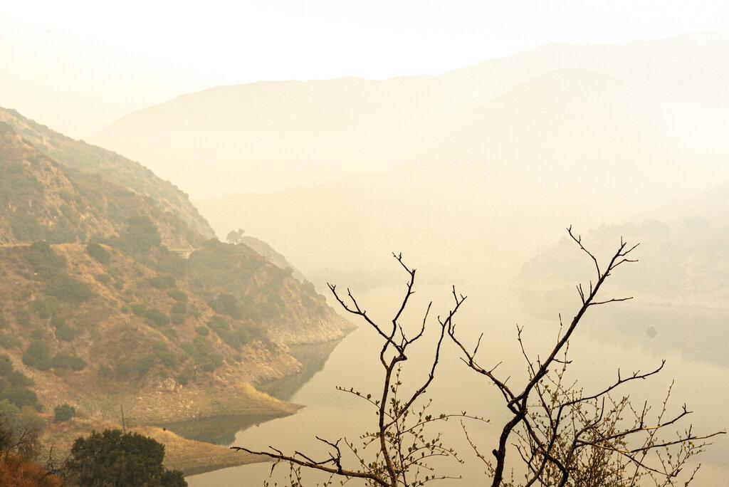 Smoke from the Bobcat Fire obscures the Morris Reservoir off Highway 39, Thursday, Sept. 10, 2020. (David Crane/The Orange County Register via AP)