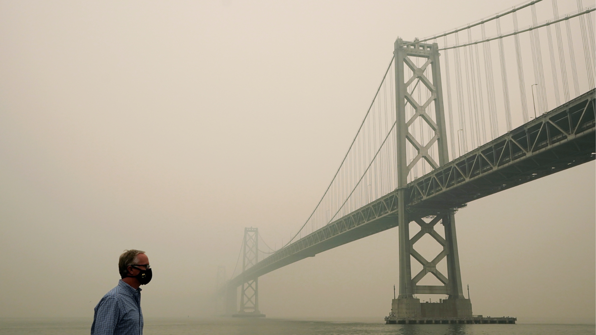 Smoke and haze from wildfires partially obscures the view of the San Francisco-Oakland Bay Bridge along the Embarcadero in San Francisco on Sept. 10, 2020. (AP Photo/Jeff Chiu)