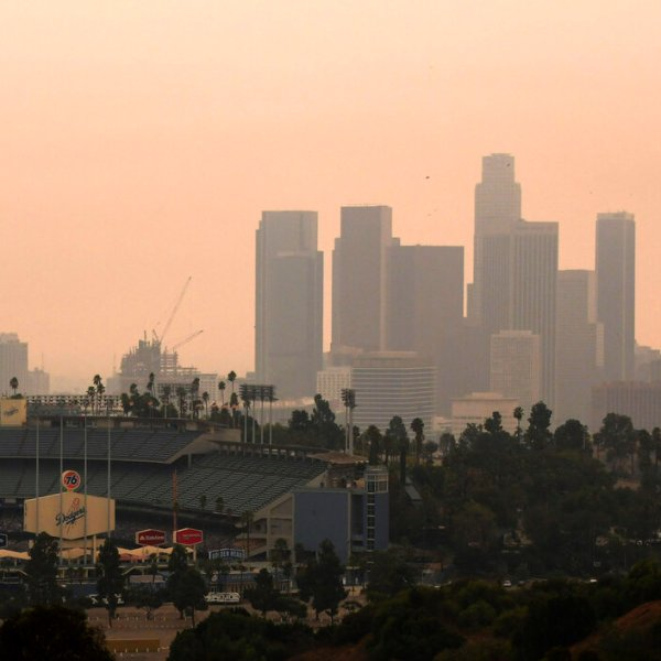 Downtown Los Angeles and Dodger Stadium are shrouded, looking south from Elysian Fields through the smoke from the Bobcat and the El Dorado fires, Friday, Sept. 11, 2020. (Keith Birmingham/The Orange County Register via AP)
