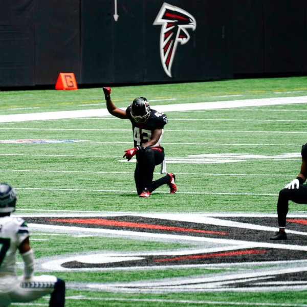 Players kneel in remembrance of Rep.. John Lewis, D-Ga., during the first half of an NFL football game between the Atlanta Falcons and the Seattle Seahawks, Sunday, Sept. 13, 2020, in Atlanta. (AP Photo/Brynn Anderson)