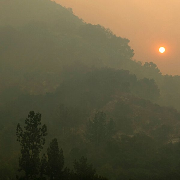 The sun rises though smoke over charred foothills above Arcadia, Calif., Monday, Sept. 14, 2020. (David Crane/The Orange County Register via AP)