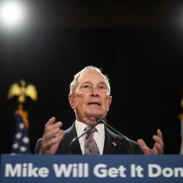 """In this Feb. 5, 2020, file photo, then-Democratic presidential candidate and former New York City Mayor Michael Bloomberg speaks at a campaign event in Providence, R.I. Bloomberg has come through on his vow to spend """"whatever it takes"""" to defeat President Donald Trump. The former presidential candidate has pledged to spend $100 million in Florida to boost Joe Biden there. (AP Photo/David Goldman, File)"""
