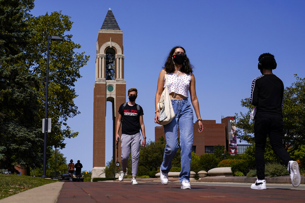 Masked students walk through the campus of Ball State University in Muncie, Ind. on Sept. 10, 2020. (AP Photo/Michael Conroy)