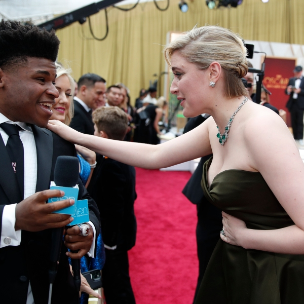 In this Feb. 9, 2020 file photo, Greta Gerwig, right, talks to Jerry Harris on the red carpet at the Oscars at the Dolby Theatre in Los Angeles. (John Locher/Associated Press)
