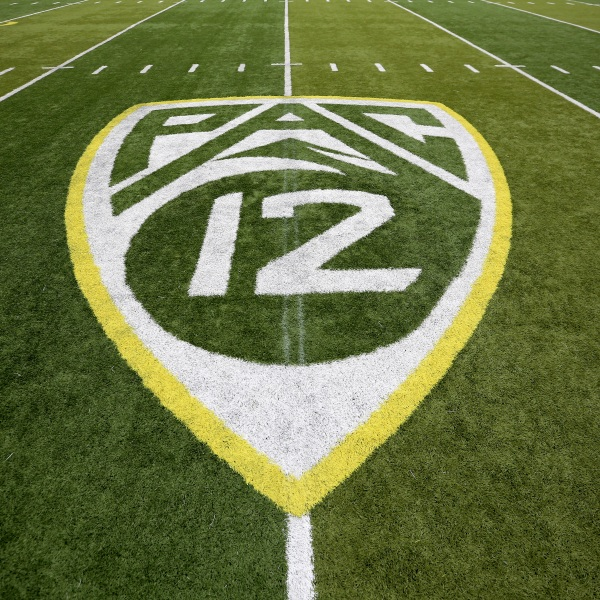 A Pac-12 logo is displayed on the field before an NCAA college football game between Washington State and Oregon in Eugene, Oregon, on Oct. 10, 2015. (Ryan Kang / Associated Press)