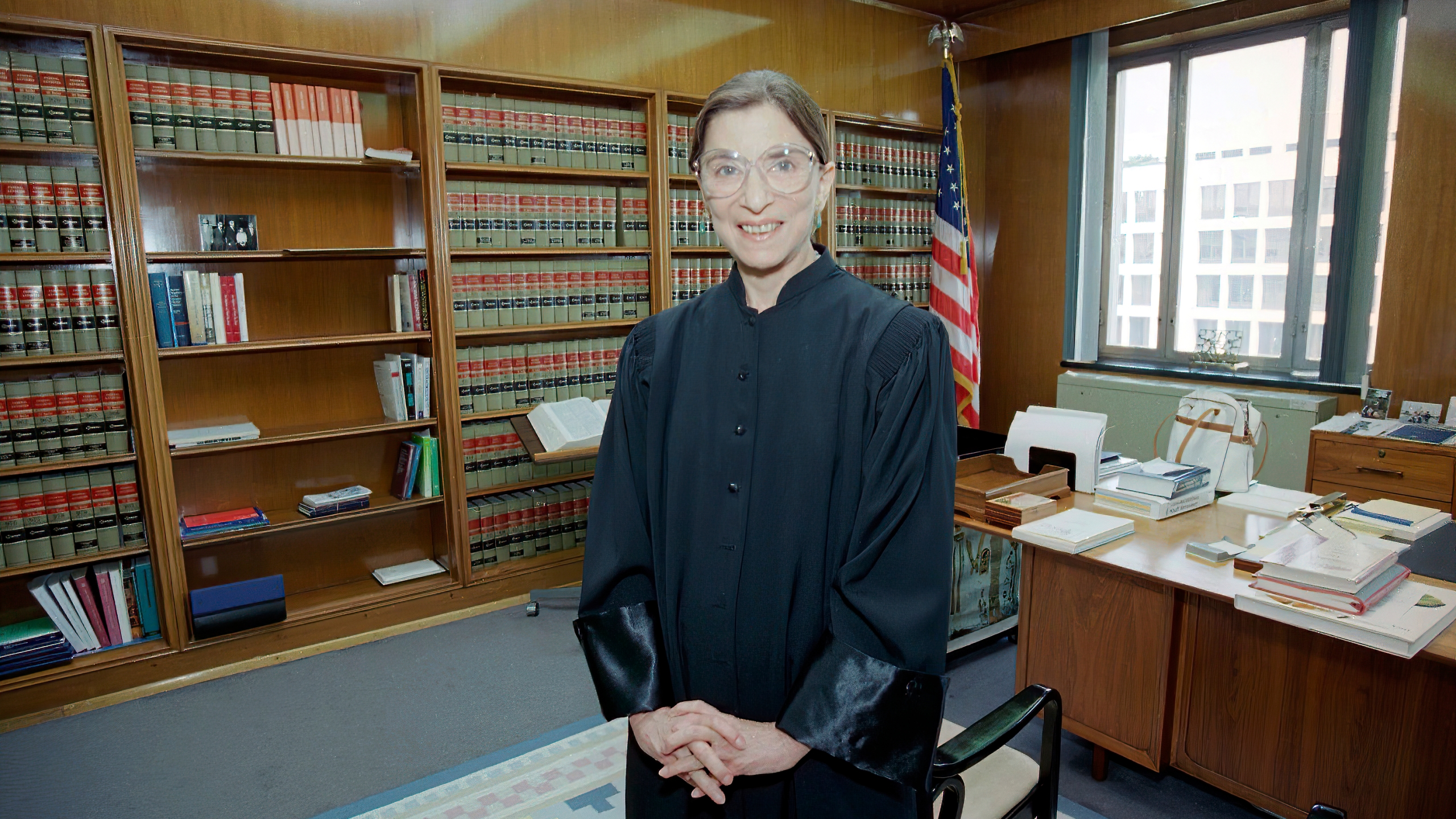 In this Aug. 3, 1993, file photo, then-Judge Ruth Bader Ginsburg poses in her robe in her office at U.S. District Court in Washington. (AP Photo/Doug Mills, File)