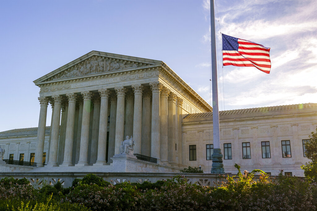 The flag flies at half-staff at the Supreme Court on the morning after the death of Justice Ruth Bader Ginsburg, 87, Saturday, Sept. 19, 2020 in Washington. (AP Photo/J. Scott Applewhite)