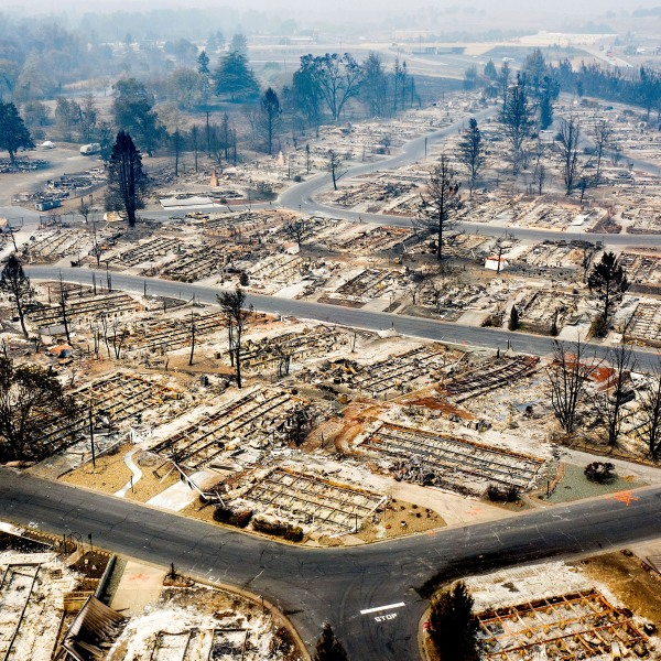 In this photo taken by a drone, homes leveled by the Almeda Fire line the Bear Lake Estates in Phoenix, Ore., Tuesday, Sept. 15, 2020. The Census Bureau is contending with several natural disasters as wildfires and hurricanes disrupt the final weeks of the nation's once-a-decade headcount. (AP Photo/Noah Berger)