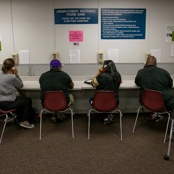 In this Sept. 20, 2013, file photo, visitors use the Unemployment Insurance phone bank at the California Employment Development Department, EDD office in Sacramento. (AP Photo/Rich Pedroncelli, File)
