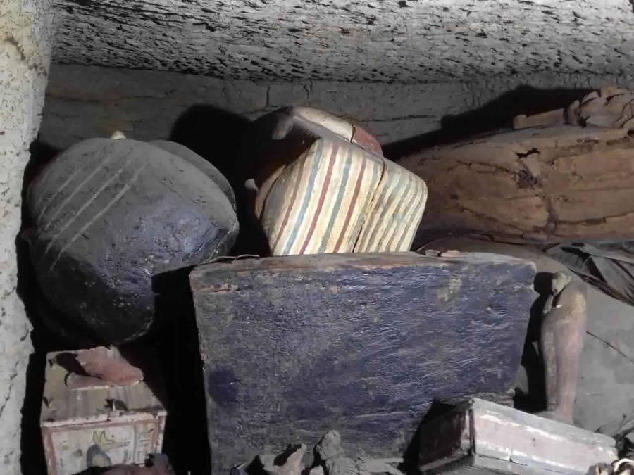 This September 2020 photo provided by the Ministry of Tourism and Antiquities shows some of the antiquities that included more than two dozen ancient coffins and other artifacts, that were unearthed near the famed Step Pyramid of Djoser in Saqqara, south of Cairo, Egypt. The Tourism and Antiquities Ministry has said initial studied show that the newly found coffins had not been opened since they were buried more than 2,500 years ago. (Ministry of Tourism and Antiquities via AP)