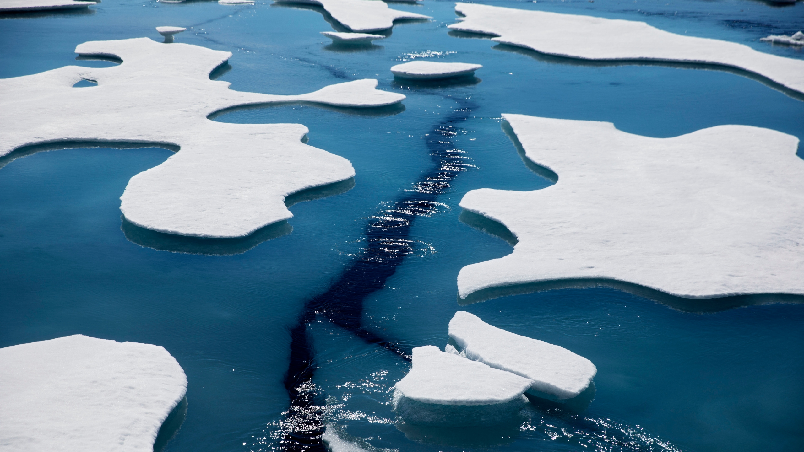 Sea ice breaks apart as the Finnish icebreaker MSV Nordica traverses the Northwest Passage through the Victoria Strait in the Canadian Arctic Archipelago in a Friday, July 21, 2017 file photo. (David Goldman/Associated Press)