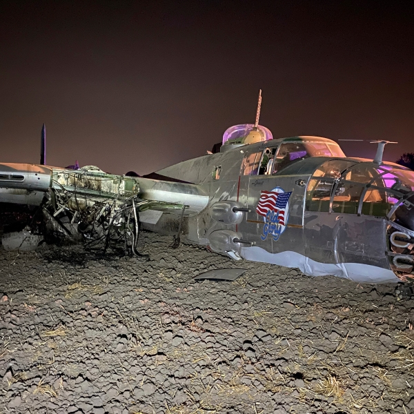 This Sept. 19, 2020, photo provided by the San Joaquin County Sheriff's Office shows a World War II era plane that crashed in Stockton. (San Joaquin County Sheriff's Office via AP)