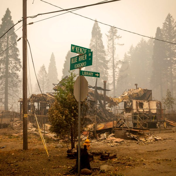 In this Sept. 15, 2020, file photo, scorched property stands at an intersection in Blue River, Ore., days after a blaze known as the Holiday Farm Fire swept through the area's business district. (Andy Nelson/The Register-Guard via AP, Pool, File)