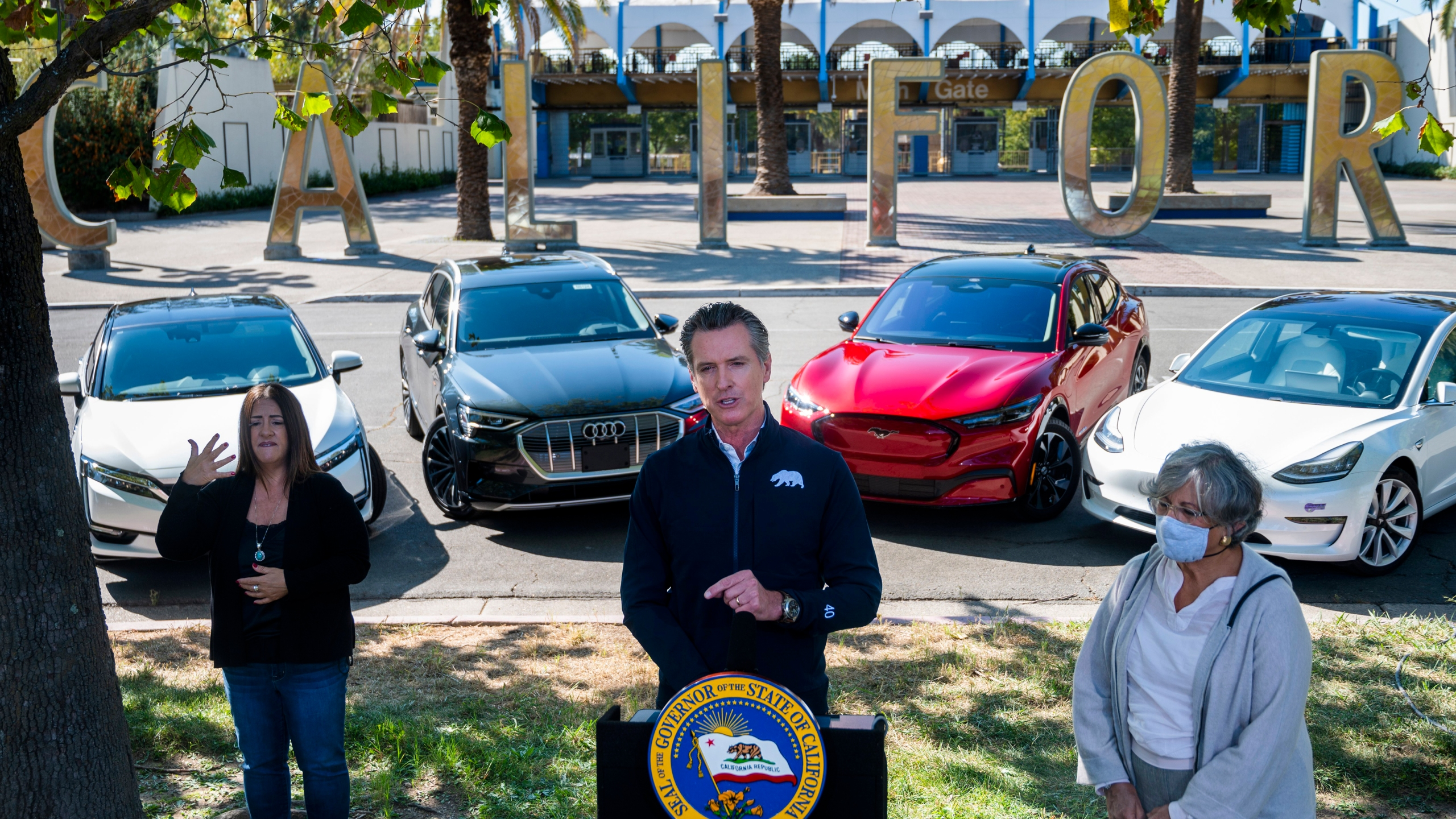 Gov. Gavin Newsom speaks at a press conference on Sept. 23, 2020, at Cal Expo in Sacramento where he announced an executive order requiring the sale of all new passenger vehicles to be zero-emission by 2035. (Daniel Kim/The Sacramento Bee via AP, Pool)