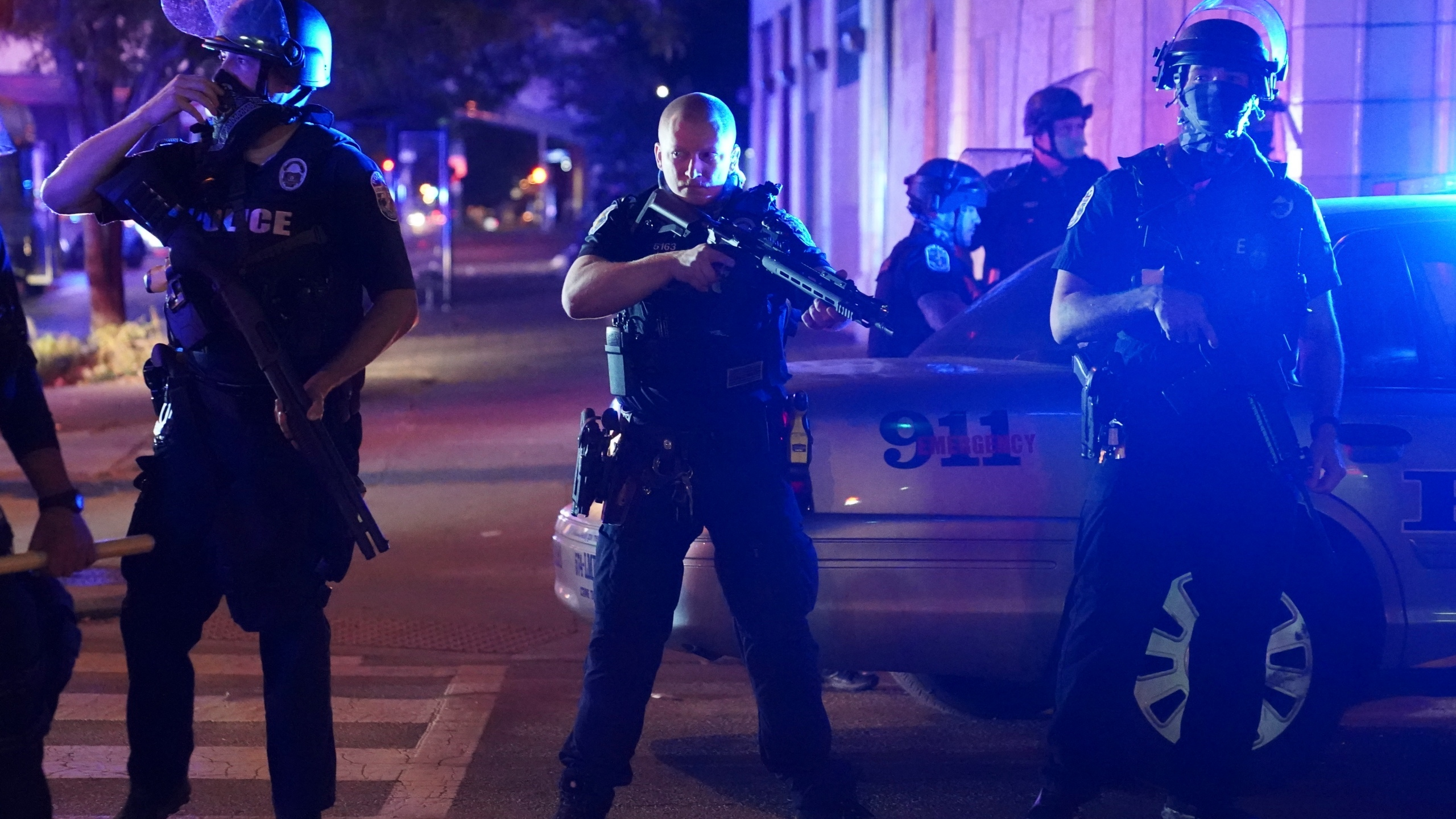 Police stand at an intersection after an officer was shot Sept. 23, 2020, in Louisville, Kentucky. (John Minchillo / Associated Press)