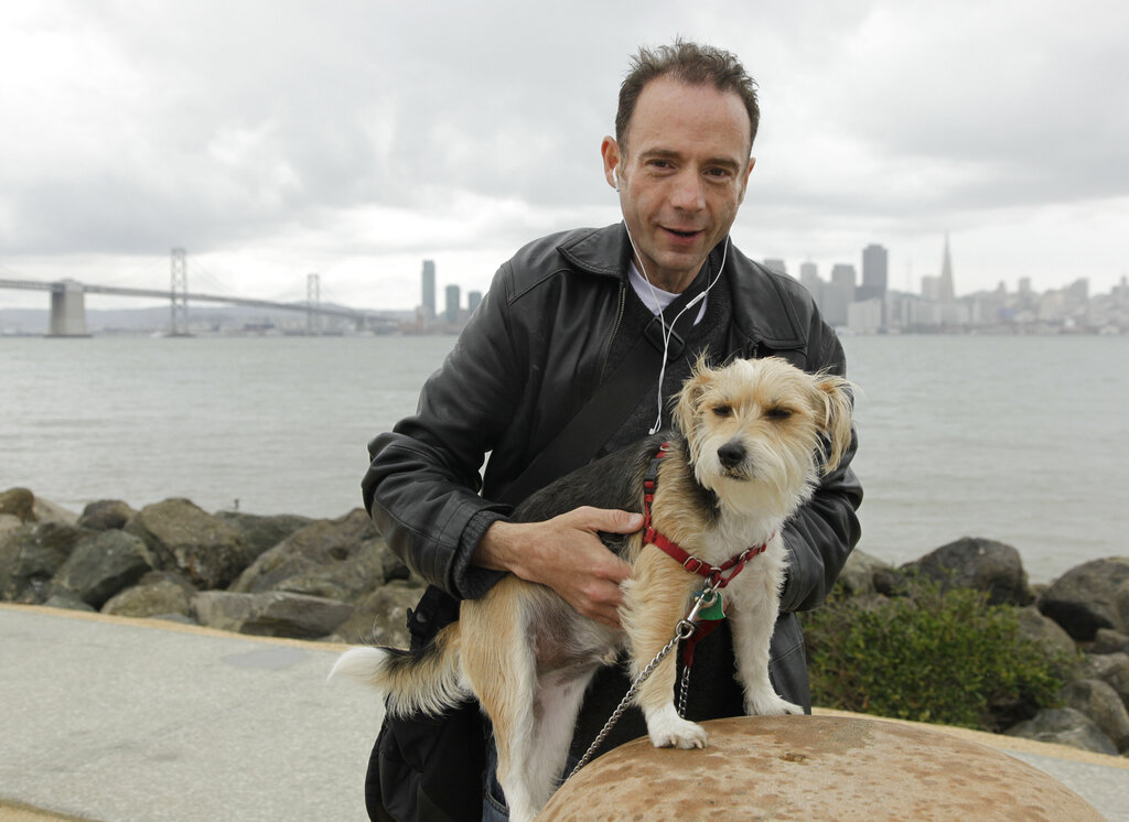 This May 16, 2011 photo shows Timothy Ray Brown with his dog, Jack, on Treasure Island in San Francisco. (AP Photo/Eric Risberg)