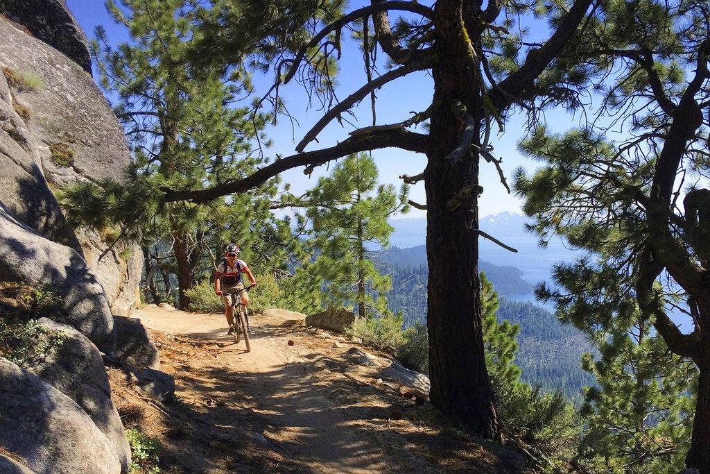 A bicyclist rides down the Flume Trail near Incline Village, Nev., on July 22, 2017. (AP Photo/Brian Melley)