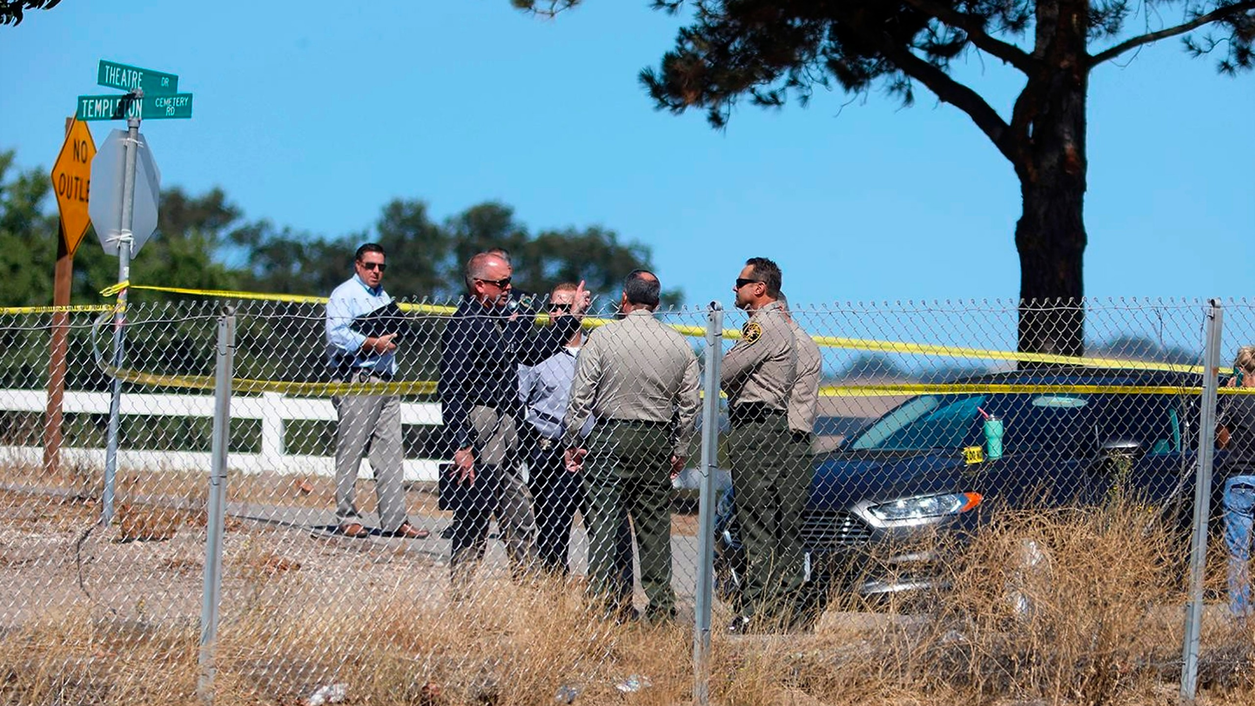 Investigators gather near the shooting scene in which a man was killed by sheriff's deputies after he shot and wounded a deputy in Templeton on Sept. 24, 2020. (Laura Dickinson / The Tribune via Associated Press)
